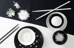 White porcelain on black and white linen tablecloths. Royalty Free Stock Images