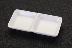 White porcelain bowl. Over black background stock images