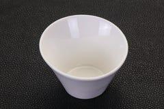 White porcelain bowl. Over black background stock photos