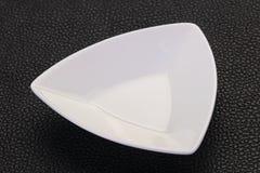 White porcelain bowl. Over black background stock photography