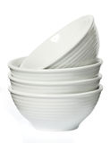 White porcelain bowls. On a seamless white background Royalty Free Stock Photos