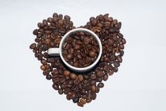 White Porcelain Cup Full Of Coffee Beans Royalty Free Stock Images