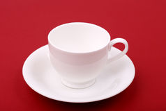 White porcelain cup on a red Royalty Free Stock Images