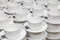 White porcelain cups for coffee or tea. coffee break at a business seminar. royalty free stock photography