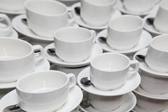 White porcelain cups for coffee or tea. coffee break at a business seminar. royalty free stock photos