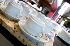 White porcelain cups with plates for cofe Royalty Free Stock Images