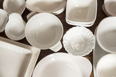 White porcelain dishes and utensils Royalty Free Stock Photos