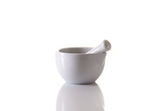 White porcelain mortar and pestle set on white Royalty Free Stock Photos