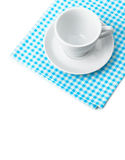 White porcelain mug with saucer tableware on cellular napkin Stock Photo