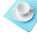 White porcelain mug with saucer tableware on cellular napkin. On white background Stock Photo