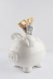 White porcelain piggy bank with three Australian fifty dollar bi Stock Photos