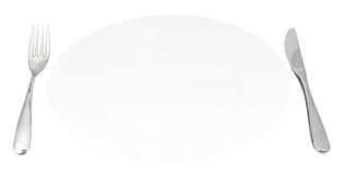 White porcelain plate with fork and knife isolated Royalty Free Stock Photo