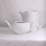White porcelain pots Stock Images