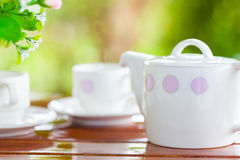 White porcelain set for tea or coffee on wooden table Royalty Free Stock Photo