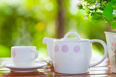 White porcelain set for tea or coffee on wooden table Stock Photography