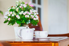 White porcelain set for tea or coffee on wooden table at home ex Royalty Free Stock Photo