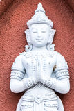 White, porcelain statuette of sitting meditating Buddha Stock Image