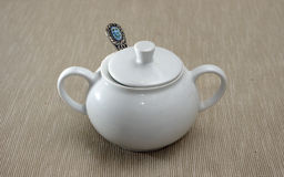 White porcelain sugar bowl with lid and spoon. Royalty Free Stock Images