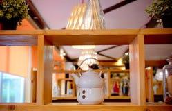 White porcelain tea set on a wooden shelf. Tea or coffee time. White ceramic tea set on a wooden shelf. White porcelain tea set on a wooden shelf. Tea or coffee stock photos