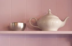 White porcelain teapot and metal sugar bowl on a p Royalty Free Stock Photography
