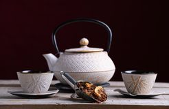 White porcelain teapot and two glasses to serve the tea with spice palin stock photo