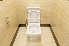 White porcelain toilet in a stall Royalty Free Stock Photography