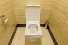 White porcelain toilet in a stall Stock Photos