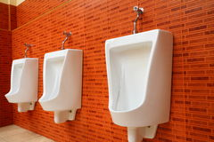White porcelain urinals Royalty Free Stock Image