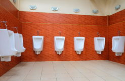 White porcelain urinals Royalty Free Stock Photo