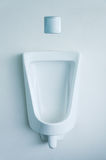White porcelain urinals. In public toilets Royalty Free Stock Photography