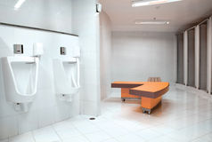 White porcelain urinals in public toilets for men Royalty Free Stock Images