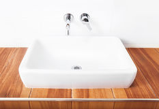 White porcelain washbasin and chrome-plated faucets. Royalty Free Stock Photos