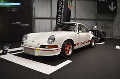 911 RS 2.7. A white Porsche 911 Carrera RS 2.7 at the Tag Heuer stand in the Milano Autoclassica exhibition. In the stand it was reproduced a racetrack starting Stock Photography