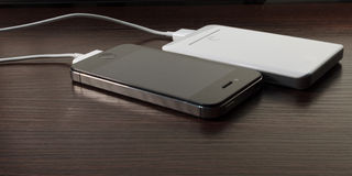 White portable power bank and mobile phone Stock Image