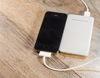 White portable power bank and mobile phone Stock Photo