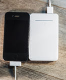White portable power bank and mobile phone Royalty Free Stock Photography