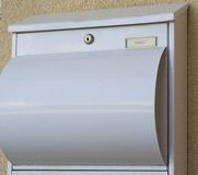 White post box made of metal. Modern white mailbox metal - closeup stock images