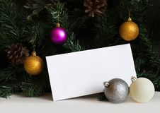 White post envelope on white table with fir tree branches and Christmas balls stock image