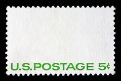 White postal stamp with the writing US Postage 5c. Stock Image