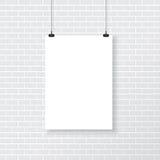 White poster on brick wall Royalty Free Stock Photos