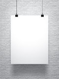 White poster on brick wall Stock Photography