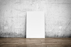 White poster on concrete wall and wood floor Royalty Free Stock Photography