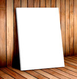 White poster frame in wooden room,mock up for your content Stock Images