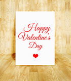 White poster with Happy Valentine's day word in wood parquet roo Royalty Free Stock Photography