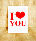 White poster with I love you word in wood parquet room, Valentin. E concept royalty free stock photo