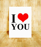 White poster with I love you word in wood parquet room, Valentin. E concept stock image