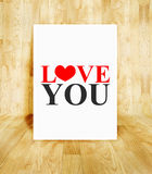 White poster with love you word in wood parquet room, Valentine. Concept stock image