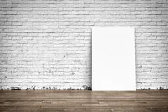 White posters on brick wall and wood floor stock photos