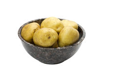 White potatoes in bowl isolated on white Stock Photos