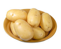 White potatoes fresh picked in bowl isolated Royalty Free Stock Photo